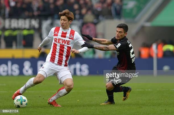 Yuya Osako of Koeln and Charles Aranguiz of Leverkusen battle for the ball during the Bundesliga match between 1 FC Koeln and Bayer 04 Leverkusen at...