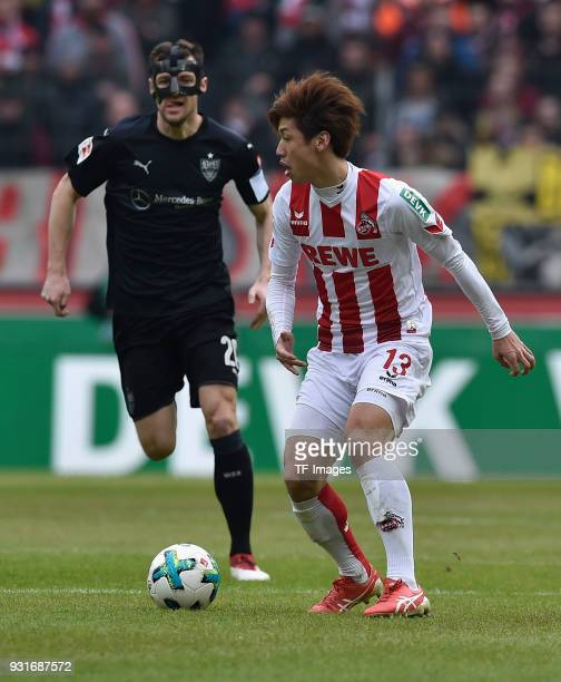 Yuya Osako of Koeln and Christian Gentner of Stuttgart battle for the ball during the Bundesliga match between 1 FC Koeln and VfB Stuttgart at...