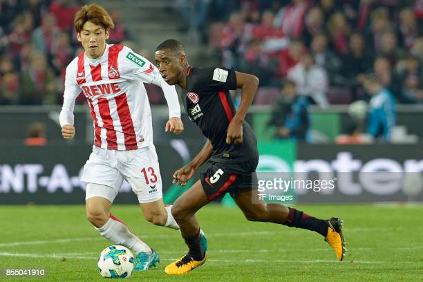 Yuya Osako of Koeln and Gelson Fernandes of Frankfurt battle for the ball during the Bundesliga match between 1 FC Koeln and Eintracht Frankfurt at...