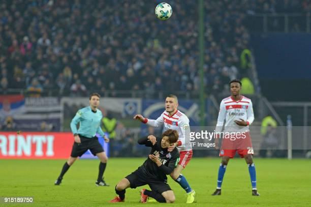 Yuya Osako of Koeln and Kyriakos Papadopoulos of Hamburg battle for the ball during the Bundesliga match between Hamburger SV and 1 FC Koeln at...