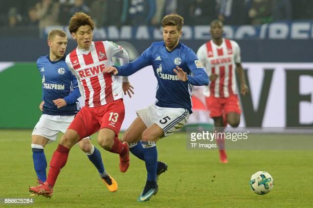Yuya Osako of Koeln and Matija Nastasic of Schalke battle for the ball during the Bundesliga match between FC Schalke 04 and 1 FC Koeln Bundesliga at...