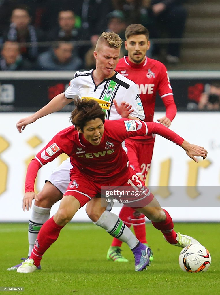 Yuya Osako of Koeln and Nico Elvedi of Borussia Moenchengladbach compete for the ball during the Bundesliga match between Borussia Moenchengladbach and 1. FC Koeln at Borussia-Park on February 20, 2016 in Moenchengladbach, Germany.