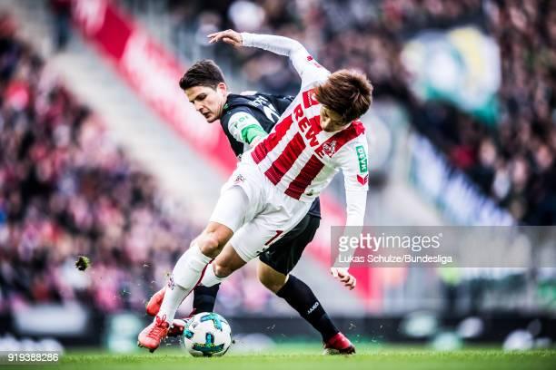 Yuya Osako of Koeln and Pirmin Schwegler of Hanover in action during the Bundesliga match between 1 FC Koeln and Hannover 96 at RheinEnergieStadion...