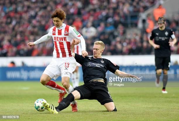 Yuya Osako of Koeln and Timo Baumgartl of Stuttgart battle for the ball during the Bundesliga match between 1 FC Koeln and VfB Stuttgart at...