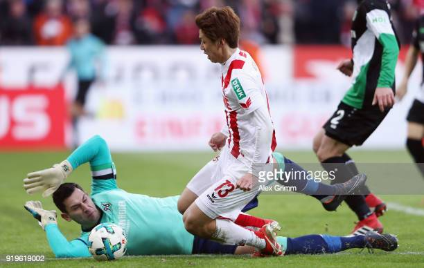 Yuya Osako of Koeln attempts to score past goalkeeper Philipp Tschauner of Hannover during the Bundesliga match between 1 FC Koeln and Hannover 96 at...