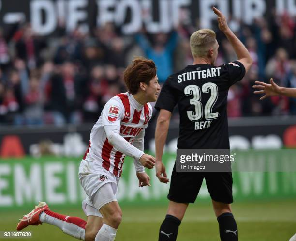 Yuya Osako of Koeln celebrates and Andreas Beck of Stuttgart gestures during the Bundesliga match between 1 FC Koeln and VfB Stuttgart at...