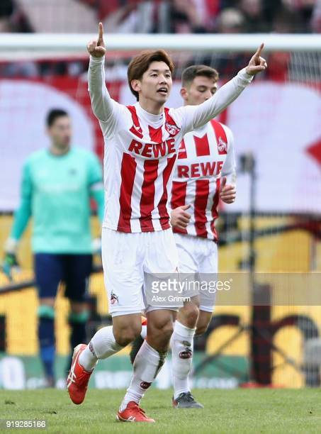 Yuya Osako of Koeln celebrates his team's first goal during the Bundesliga match between 1 FC Koeln and Hannover 96 at RheinEnergieStadion on...