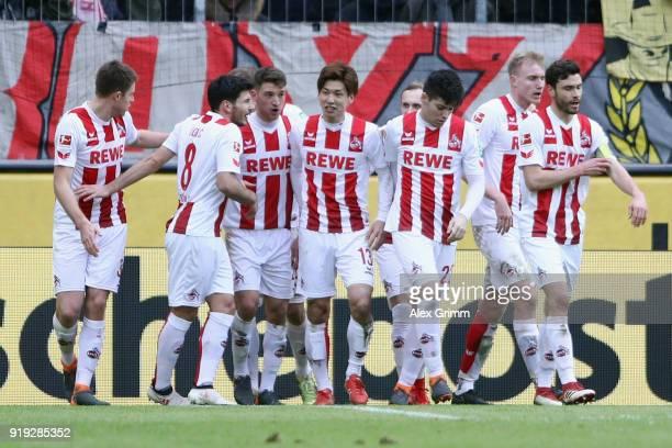 Yuya Osako of Koeln celebrates his team's first goal with team mates during the Bundesliga match between 1 FC Koeln and Hannover 96 at...