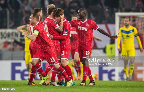Yuya Osako of Koeln celebrates his teams second goal with team mates during the UEFA Europa League group H match between 1 FC Koeln and BATE Borisov...