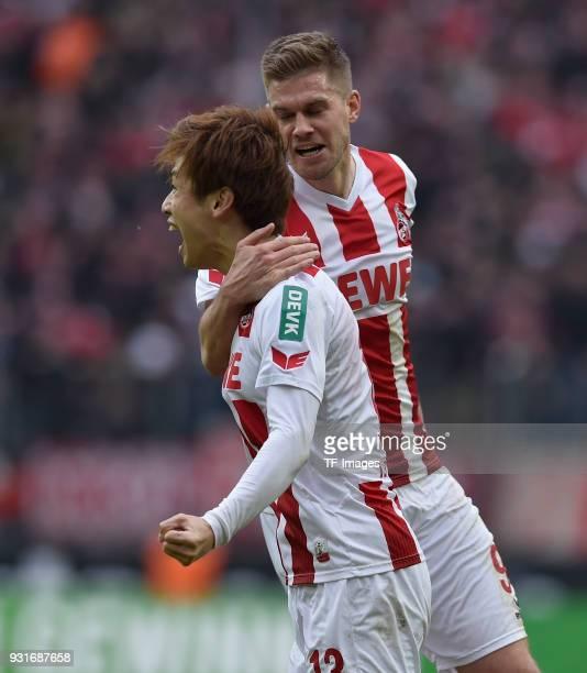 Yuya Osako of Koeln celebrates with Simon Terodde of Koeln during the Bundesliga match between 1 FC Koeln and VfB Stuttgart at RheinEnergieStadion on...