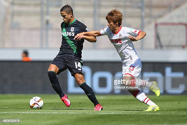 Yuya Osako of Koeln challenges Ibrahim Affelay of Stoke City during the Colonia Cup 2015 match between 1 FC Koeln and Stoke City FC at...