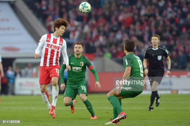 Yuya Osako of Koeln Daniel Baier of Augsburg and Rani Khedira of Augsburg battle for the ball during the Bundesliga match between 1 FC Koeln and FC...