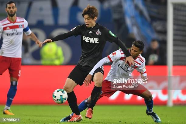 Yuya Osako of Koeln fights for the ball with Douglas Santos of Hamburg during the Bundesliga match between Hamburger SV and 1 FC Koeln at...