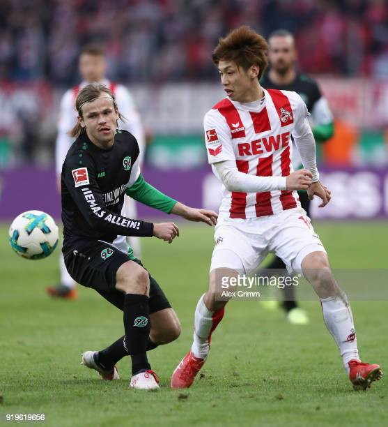 Yuya Osako of Koeln is challenged by Iver Fossum of Hannover during the Bundesliga match between 1 FC Koeln and Hannover 96 at RheinEnergieStadion on...