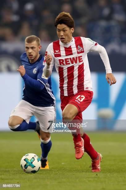 Yuya Osako of Koeln runs with the ball during the Bundesliga match between FC Schalke 04 and 1 FC Koeln at VeltinsArena on December 2 2017 in...