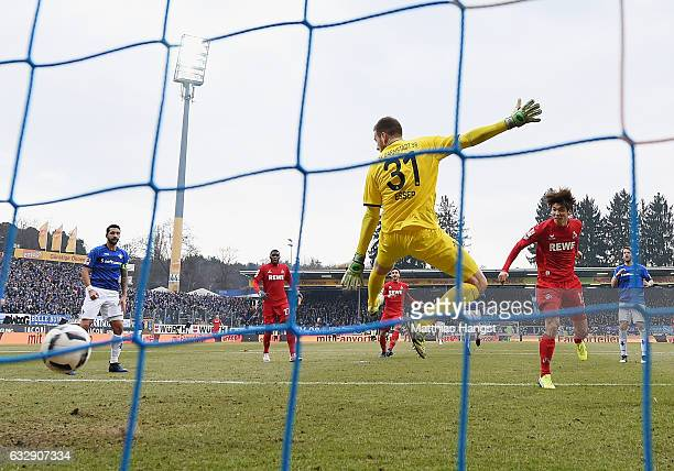 Yuya Osako of Koeln scores his team's second goal during the Bundesliga match between SV Darmstadt 98 and 1 FC Koeln at Stadion am Boellenfalltor on...