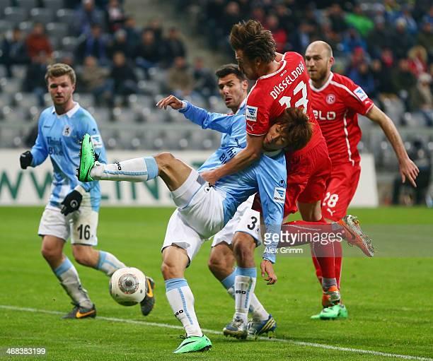 Yuya Osako of Munich is challenged by Adam Bodzek of Duesseldorf during the Second Bundesliga match between TSV 1860 Muenchen and Fortuna Duesseldorf...