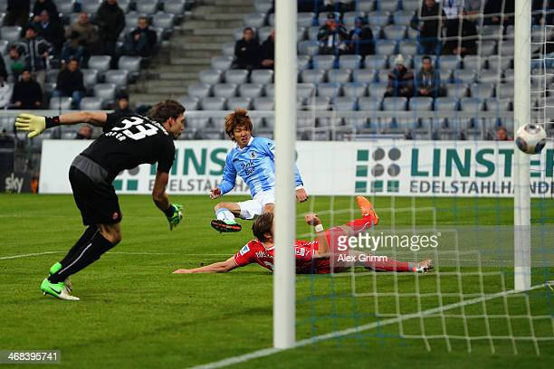 Yuya Osako of Munich scores his team's first goal against goalkeeper Fabian Giefer of Duesseldorf during the Second Bundesliga match between TSV 1860...