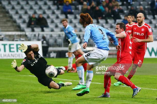 Yuya Osako of Munich tries to score against goalkeeper Fabian Giefer of Duesseldorf during the Second Bundesliga match between TSV 1860 Muenchen and...