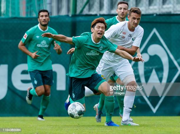 Yuya Osako of SV Werder Bremen and David Gugganig of WSG Wattens battle for the ball during the friendly match between SV Werder Bremen and WSG...
