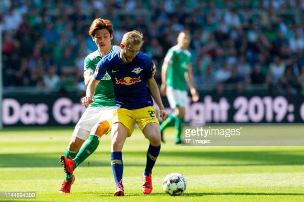 Yuya Osako of SV Werder Bremen and Konrad Laimer of RB Leipzig battle for the ball during the Bundesliga match between SV Werder Bremen and RB...