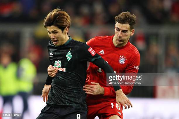 Yuya Osako of SV Werder Bremen and Leon Goretzka of FC Bayern Muenchen battle for the ball during the Bundesliga match between FC Bayern Muenchen and...