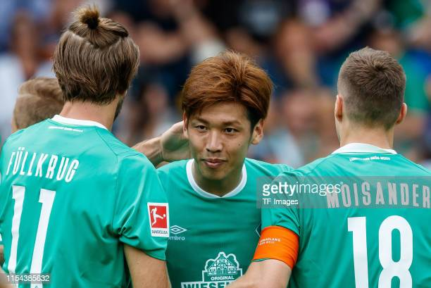 Yuya Osako of SV Werder Bremen celebrates after scoring his team's first goal with team mates during the friendly match between SV Werder Bremen and...