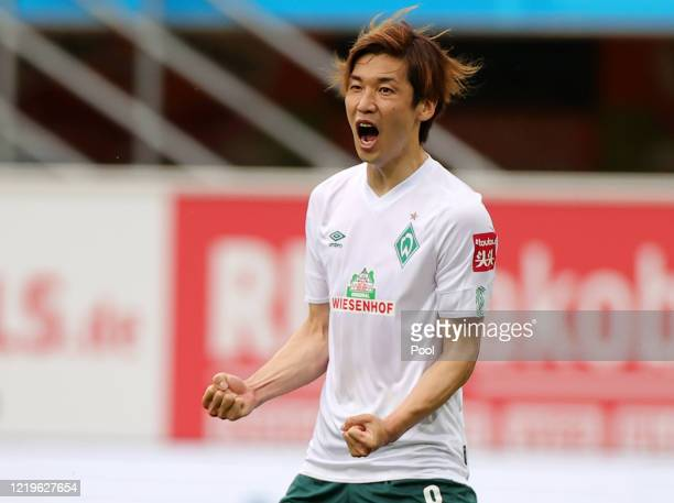 Yuya Osako of SV Werder Bremen celebrates after scoring his team's second goal during the Bundesliga match between SC Paderborn 07 and SV Werder...