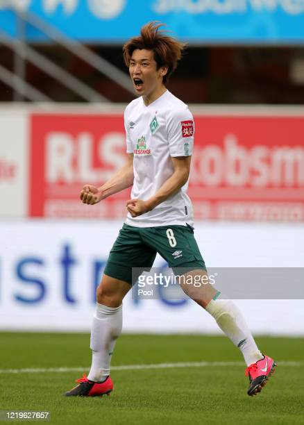 Yuya Osako of SV Werder Bremen celebrates after scoring his team's second goal during the Bundesliga match between SC Paderborn 07 and SV Werder...