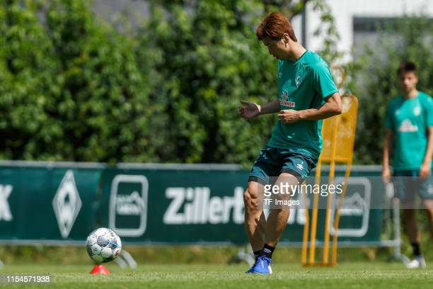 Yuya Osako of SV Werder Bremen controls the ball during a training session at the Werder Bremen training center at Stadion am Zoo on July 6 2019 in...