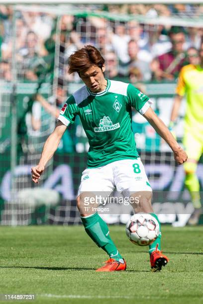 Yuya Osako of SV Werder Bremen controls the ball during the Bundesliga match between SV Werder Bremen and RB Leipzig at Weserstadion on May 18 2019...
