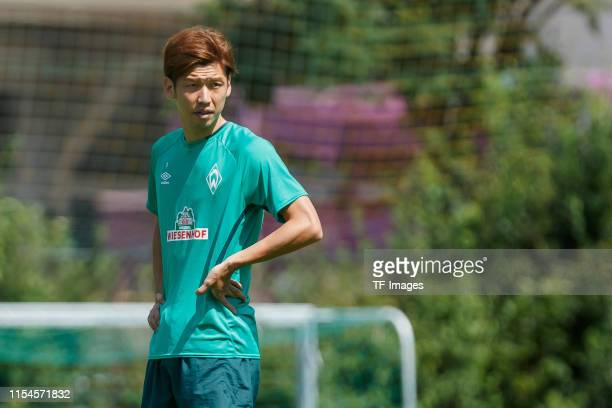Yuya Osako of SV Werder Bremen looks on during a training session at the Werder Bremen training center at Stadion am Zoo on July 6 2019 in Zell am...
