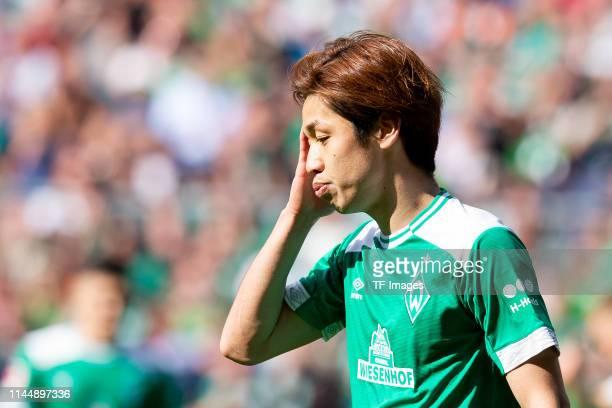 Yuya Osako of SV Werder Bremen looks on during the Bundesliga match between SV Werder Bremen and RB Leipzig at Weserstadion on May 18 2019 in Bremen...