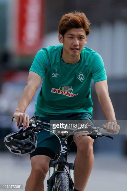 Yuya Osako of SV Werder Bremen rids a bike during a training session at the Werder Bremen training center at Stadion am Zoo on July 6 2019 in Zell am...