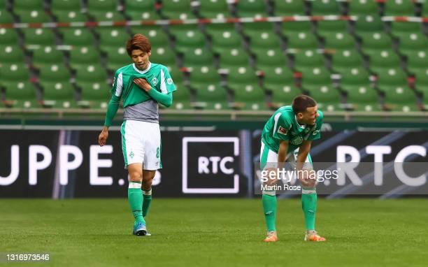Yuya Osako of Werder Bremen and Maximilian Eggestein of Werder Bremen look dejected following the Bundesliga match between SV Werder Bremen and Bayer...
