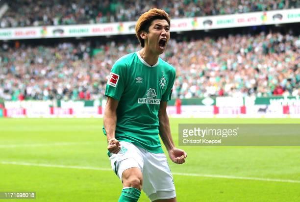 Yuya Osako of Werder Bremen celebrates after scoring his sides third goal during the Bundesliga match between SV Werder Bremen and FC Augsburg at...