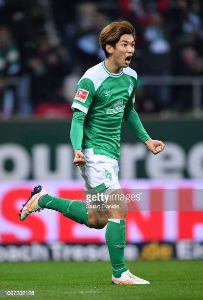 Yuya Osako of Werder Bremen celebrates after scoring his team's first goal during the Bundesliga match between SV Werder Bremen and FC Bayern...
