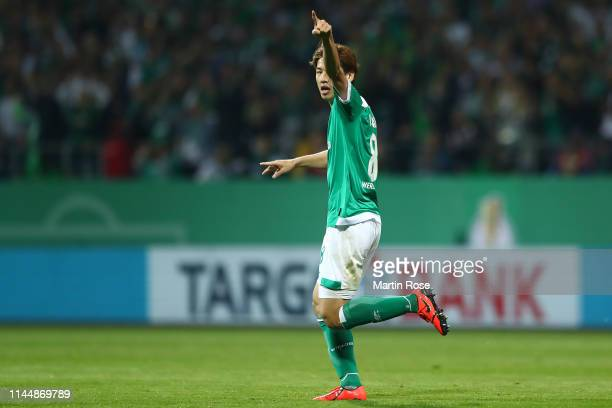 Yuya Osako of Werder Bremen celebrates after scoring his team's first goal during the DFB Cup semi final match between Werder Bremen and FC Bayern...