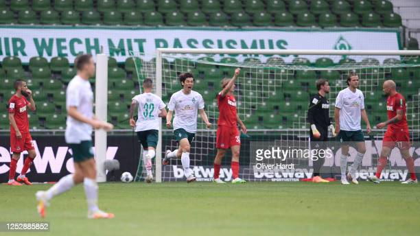 Yuya Osako of Werder Bremen celebrates scoring his teams first goal of the game during the Bundesliga match between SV Werder Bremen and 1 FC Koeln...