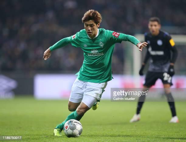 Yuya Osako of Werder Bremen runs with the ball during the Bundesliga match between SV Werder Bremen and FC Schalke 04 at Wohninvest Weserstadion on...