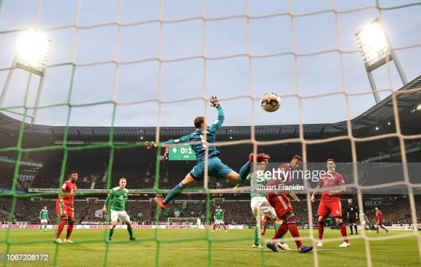 Yuya Osako of Werder Bremen scores his team's first goal past Manuel Neuer of Bayern Munich during the Bundesliga match between SV Werder Bremen and...