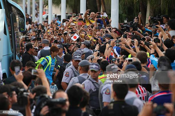 Yuya Osako walks through the crowd as he gets off the bus for a Japan training session held at Walter Riberio Stadium on June 8 2014 in Sorocaba Sao...