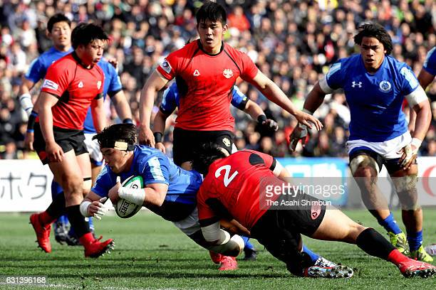 Yuya Otsuka of Tokai dives to score the opening try during the 53rd Rugby Japan University Championship final at Prince Chichibu Memorial Rugby...