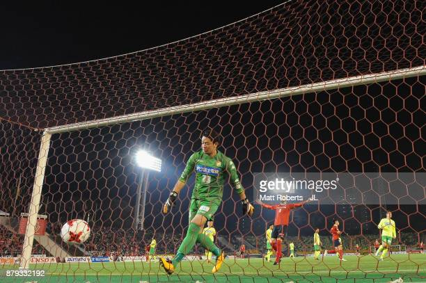 Yuya Sato of JEF United Chiba picks up the ball from the back of the net after Nagoya Grampus' fourth goal during the JLeague J1 Promotion PlayOff...