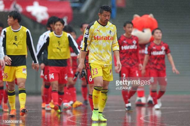 Yuya Sato of Roasso Kumamoto shows dejection after the 2-2 draw in the J.League Meiji Yasuda J3 match between Roasso Kumamoto and Kagoshima United at...