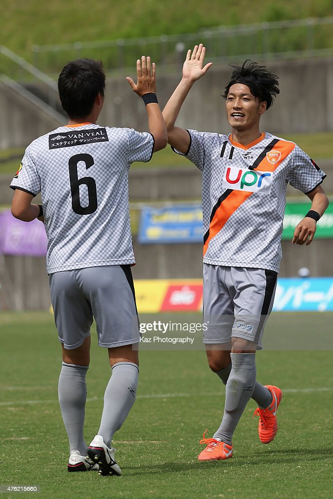 Yuya Torikai (R) of Renofa Yamaguchi celebrates scoring his team's second goal with his team mate Kyohei Kuroki (L) during the J.League third division match between Fujieda MYFC and Renofa Yamaguchi at Fujieda Stadium on June 7, 2015 in Fujieda, Shizuoka, Japan.