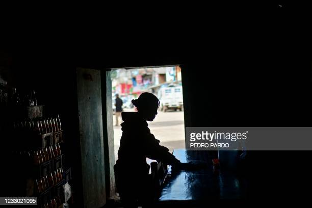 Yuyu Ortiz works at her family's restaurant in Metlatonoc municipality, Guerrero state, Mexico, on May 16, 2021. - In this southern community in the...