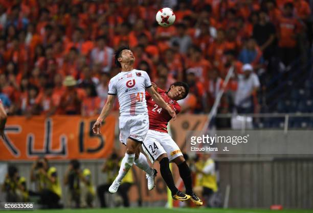 Yuzo Iwakami of Omiya Ardija and Takahiro Sekine of Urawa Red Diamonds compete for the ball during the JLeague J1 match between Urawa Red Diamonds...