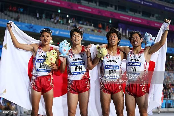 Yuzo Kanemaru Kenji Fujimitsu Shota Iizuka and Nobuya Kato of Japan celebrates claiming the Gold medal in the Men's 4x400m Relay Final during day...