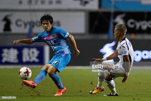 Yuzo Kobayashi of Sagan Tosu and Yosuke Ideguchi of Gamba Osaka compete for the ball during the JLeague J1 match between Sagan Tosu and Gamba Osaka...